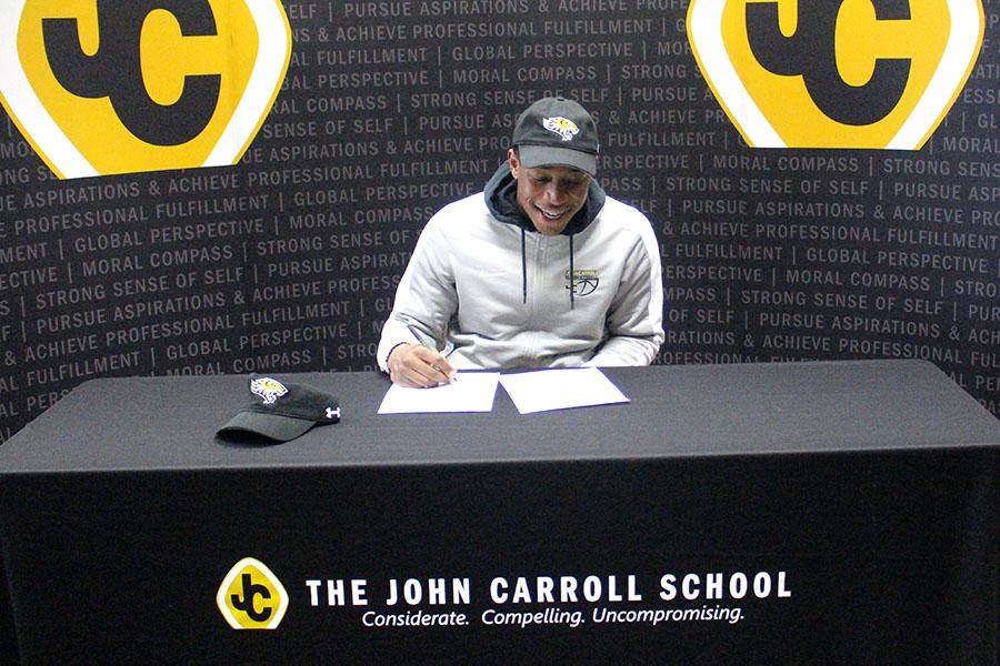 Senior Malik Tyne signs his National Letter of Intent to play Division 1 football at Towson University. Tyne played high school football for the first time this year for his senior year. He came to JC his sophomore year to play basketball and immediately made varsity.