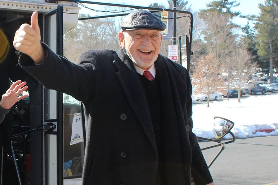 Dr. Werner Cohen gives a thumbs up to the seniors greeting him and other Holocaust survivors. In 1938 Cohen was sent to the Dachau concentration camp at the age of 16 and was then released to travel to England.
