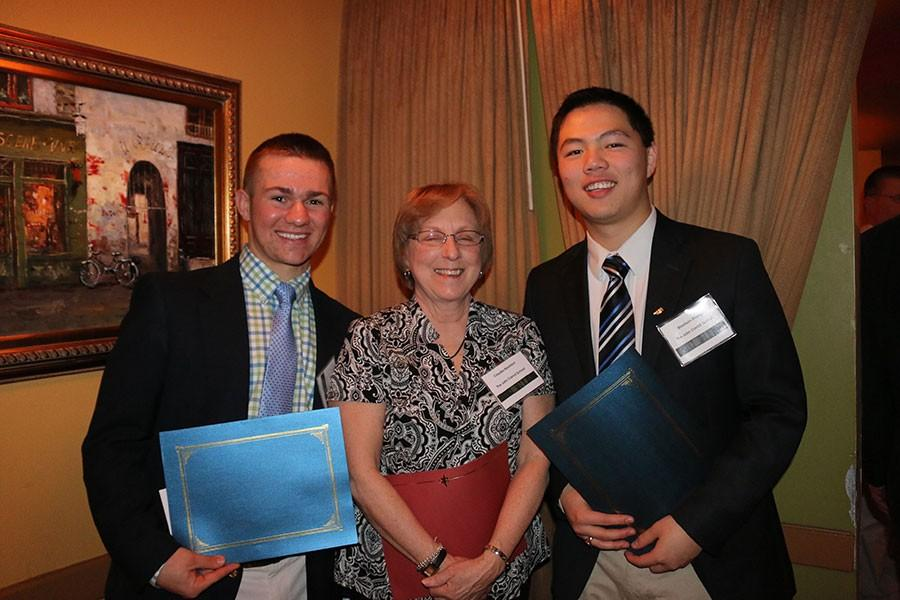 Senior Tim Kutcher, math teacher Claudia Reyerson, and senior Rawlison Zhange (left to right) pose with their math awards from the 4th Annual William J. Sacco Awards Banquet on March 8. The banquet honored excellence in math in Harford County.