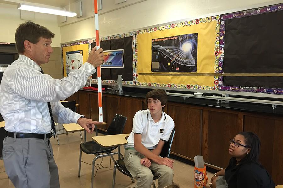 STEM Coordinator Michael Monaghan shows students in STEM how tall 56 in. would be. In STEM group, students were challenged to build towers as tall as possible with only one set of Jenga blocks.