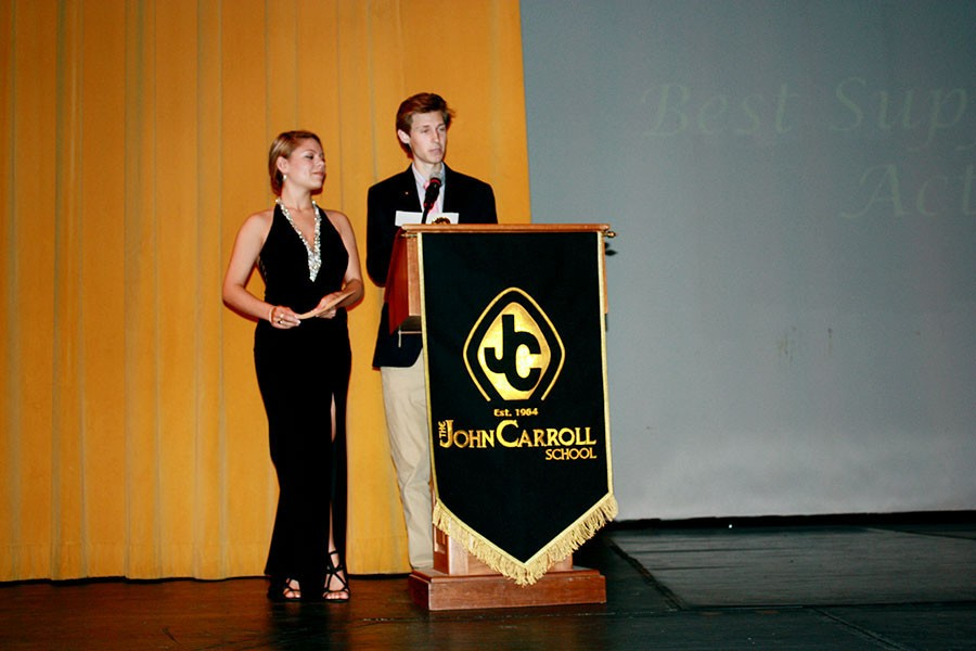 Seniors Emma Kleinburg and Drew Cook announce the best supporting actor award for the 2014-2015 school year. Senior Scott Walczyk received the award for his roles in