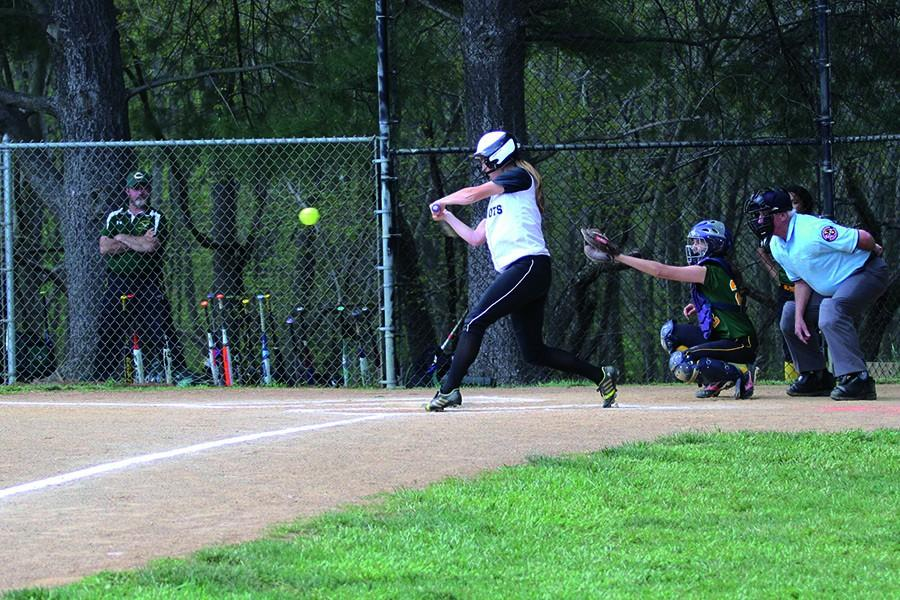 Sophomore Gabriella Centi smacks a hit in the varsity softball game against Catholic High on April 29. Centi's hitting has been a crucial part of the softball team's four and three record, placing them sixth in the IAAM.