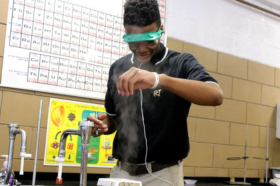 Junior Kevin Kangu experiments with a hot plate in chemistry class. Chemistry teacher Shane Lawler took his class to the lab May 22.