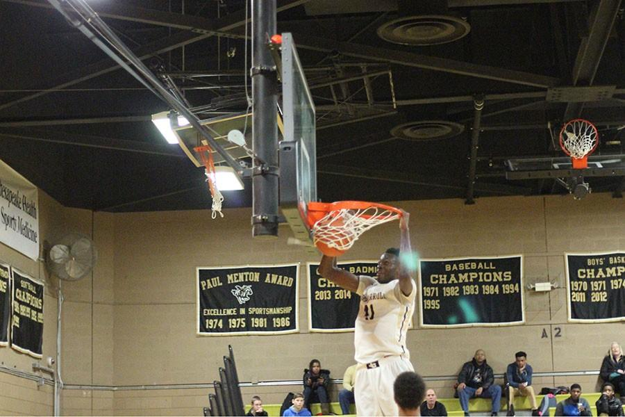 Senior Michael Tertsea dunks the ball during last year's home game against Mount St. Joe. Tertsea has recently committed to Rhode Island University to play collegiate basketball.