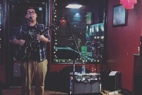 "Senior Conrad Gangon performs his original song, ""Christmas Lights,"" at Dangerously Delicious. Gangon recently signed his solo act, Samurai Tiger, to the record label Non-Denomenational Emo."