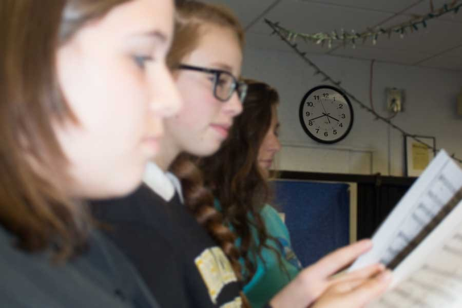 Chorus students participate in class as the clock hits 3:40 p.m. Since the class extends past 3:30, students are at least 10 minutes late to practices.