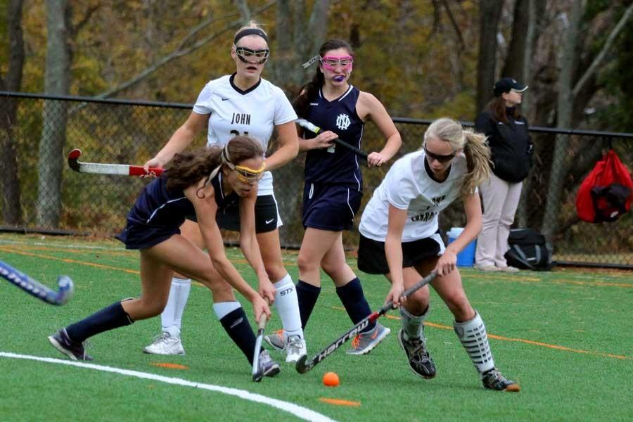 Sophomore right wing Ashlee Kothenbeutel dodges a defender on the edge of the circle. The team beat IND in the first game of the semifinals, 4-1, on Oct. 27, and went on to beat Indian Creek Oct. 29 to advance to the championship.