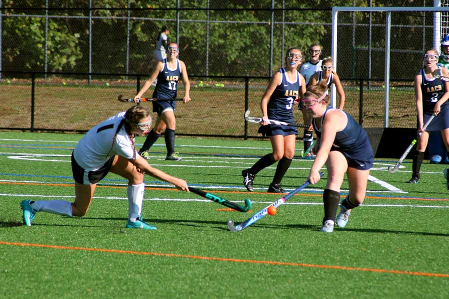 Senior right midfielder and team captain Carly Lyon flicks the ball to the left of the defender to carry the ball into the circle. The varsity field hockey team played against Annapolis Area Christian School on Wednesday and won 5-1 to maintain their undefeated record.