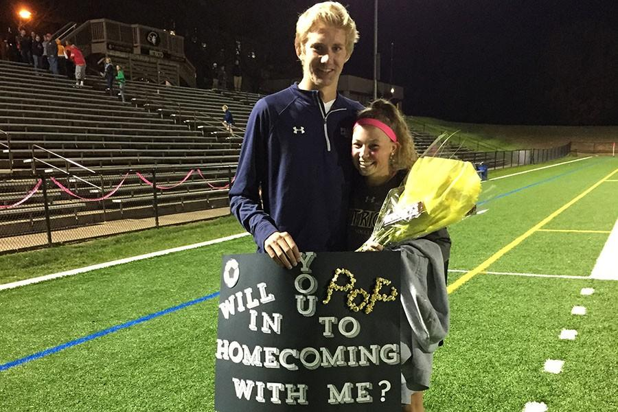 Senior Jake Dengler asks fellow senior Mary Kate Gerety to homecoming after her varsity soccer game. Homecoming proposals are traditionally meant to be creative and features the guy asking the girl.