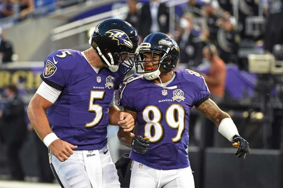 Baltimore Ravens quarterback Joe Flacco, left, celebrates with wide receiver Steve Smith Sr., after the two connected for a 63-yard touchdown against the Washington Redskins in the first quarter during preseason action at M & T Bank Stadium in Baltimore on Saturday, Aug. 29, 2015. The Redskins won, 31-13. (Kenneth K. Lam/Baltimore Sun/TNS)