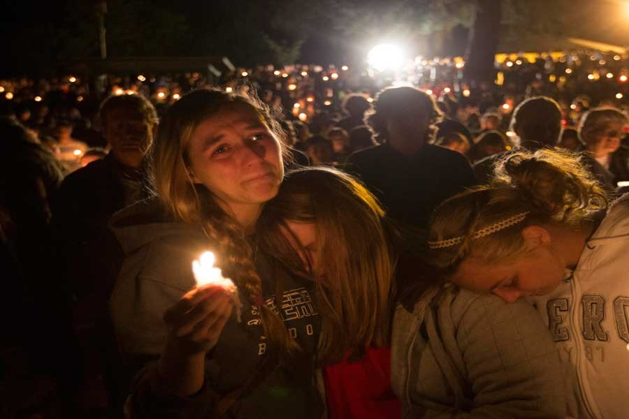 A group of young women console each other during a vigil on Oct. 1, 2015 in Roseburg, Ore. after a shooter opened fire at the Umpqua Community College, killing several.