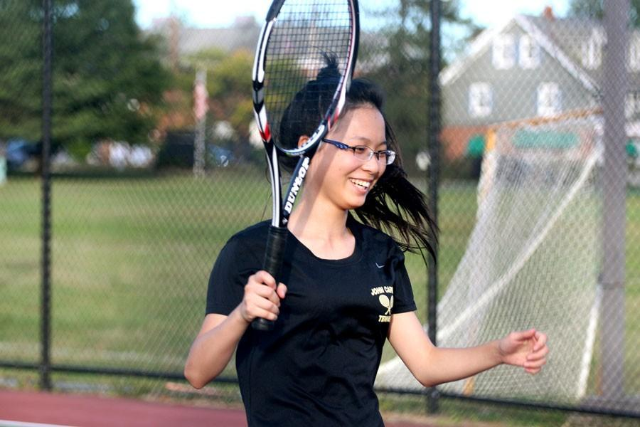 Senior Vanilla Tong prepares to hit a volley during her tennis match. The varsity women's tennis team currently has a record of 2-2.