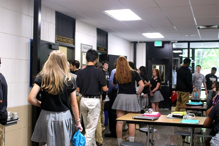 Students try to buy food during the mod 5 lunch mod, which has over 300 students scheduled for lunch. The new schedule has two lunch mods with approximately half the school off per mod.