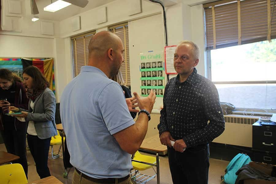 JC German teacher Richard Möller gets to know Herbert Beste, German teacher from Gymnasium Josephinum. The two had a long conversation in both German and English at the German exchange breakfast, setting an example for their students.
