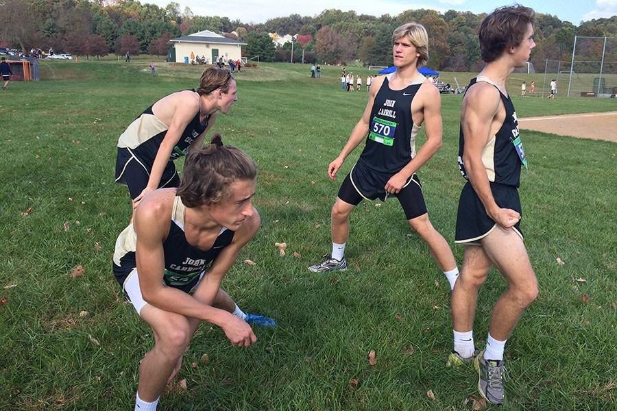Seniors Rob Flynn, Evan Moore, Michael Imbierowicz, and sophomore Ben Sullivan, members of the men's varsity cross country team, warm up minutes before their race. The team raced in the Harford Invitational at Tollgate Park on Oct. 22 and placed fourth overall in the county.