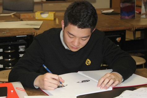 "Senior Chul Park is currently working on a project called ""Insight."" He is going to draw a series of 12 pairs of human eyes with animal skin, representing the connection between humans and animals and the Chinese Zodiac."