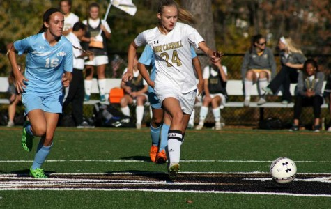 Senior varsity captain and forward Kristen Isoldi dribbles downfield with two C. Milton Wright players close behind. The women's soccer team defeated C. Milton Wright 2-1 on Oct. 23.