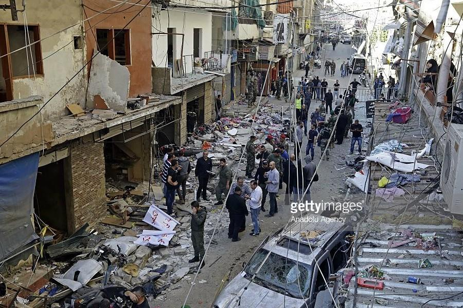 Lebanese people inspect an area where two explosions took place at Dahieh, know as Hezbollah stronghold, South Beirut, Lebanon on November 13, 2015. [A possible 26-35] people were killed and another 180 injured by double bombings.