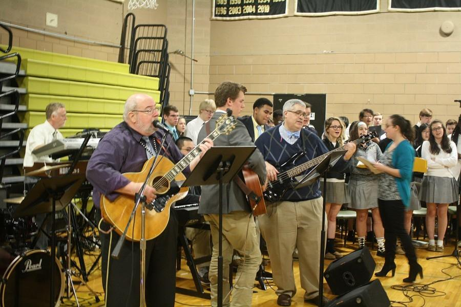 Dean of Students Sean Ireton and his brother Kevin Ireton lead the school in song during the Thanksgiving prayer service. The service was held on Friday, Nov. 20, and the theme was