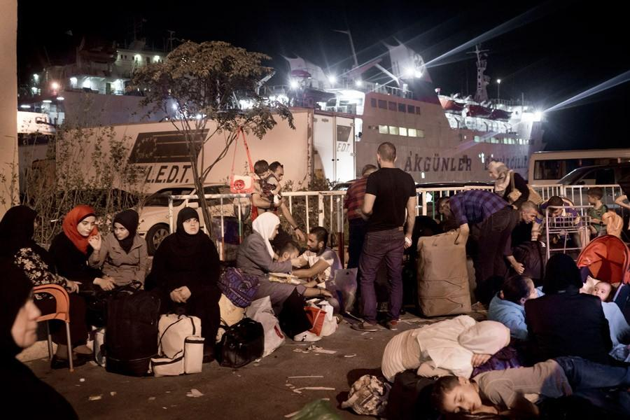 Syrian refugees at the port of Tripoli, Lebanon, waiting to board the ferry Lady Su, which travels to Tasucu, Turkey, in a twelve-hour journey. The ferry, which was scheduled to depart at 10 p.m. on September 21, left the port at 10 a.m. the following day due to regular delays and an truck accident during loading.