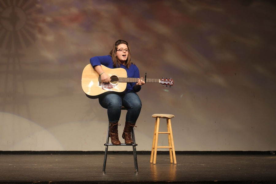 Senior Julia Henninger plays guitar and sings at Variety Show rehearsal. The Seniors have spent the week rehearsing for the show, which will be their only class fundraiser.