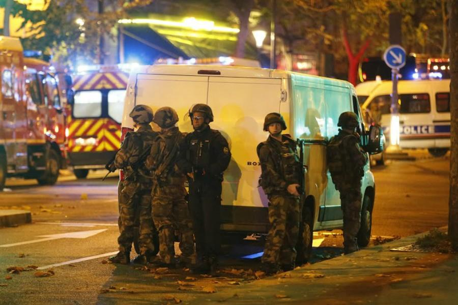 Security forces and police outside the Bataclan concert hall in central Paris as people are being held hostage on Friday, Nov. 13, 2015. After clearing the hall of attackers, officials reportedly found more than 100 dead inside.