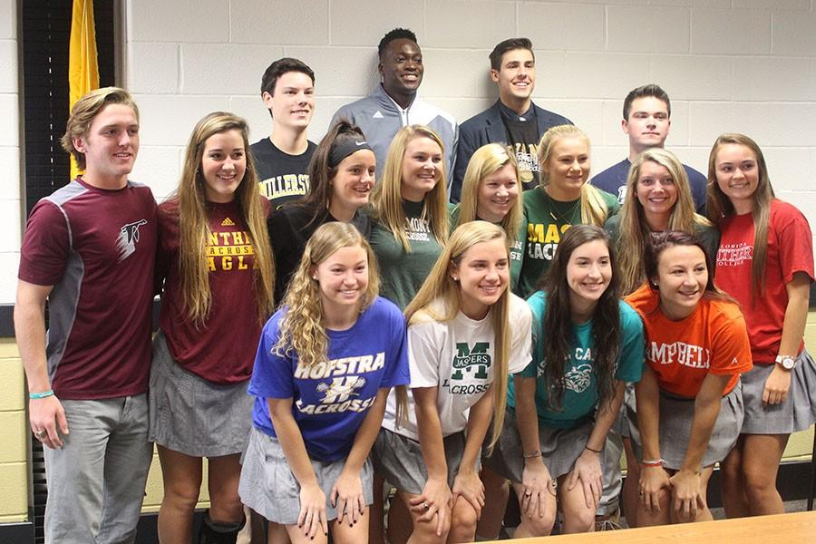 Members of the class of 2016 gather after signing their National Letters of Intent on Nov. 17. The student athletes who signed were members of the lacrosse, baseball, and mens basketball teams.