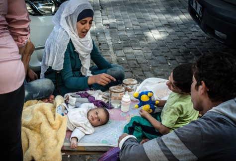 A Syrian family stays on the street where they have been sleeping in Izmir, Turkey, while they attempt to reach Greece by boat on Sept. 3, 2015.