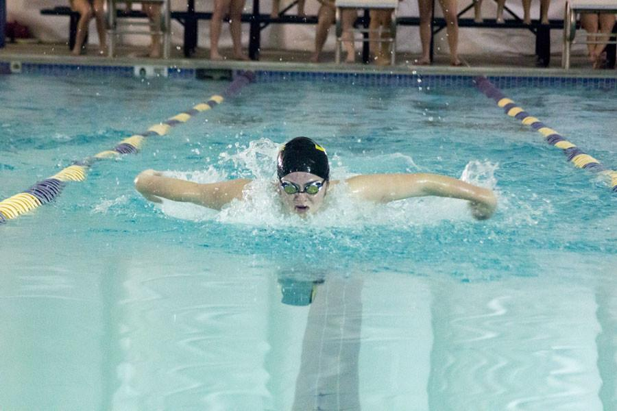 Senior Julia Dukes comes up for breath while performing the butterfly stroke during swim practice. According to her teammates, Dukes is one of the teams strongest swimmers and led the womens team last season.