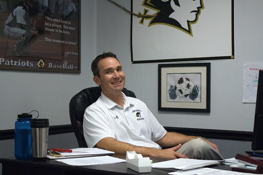 Athletic Director Steve Teter works at his desk. Teter was appointed the Athletic Director Feb. of this year.