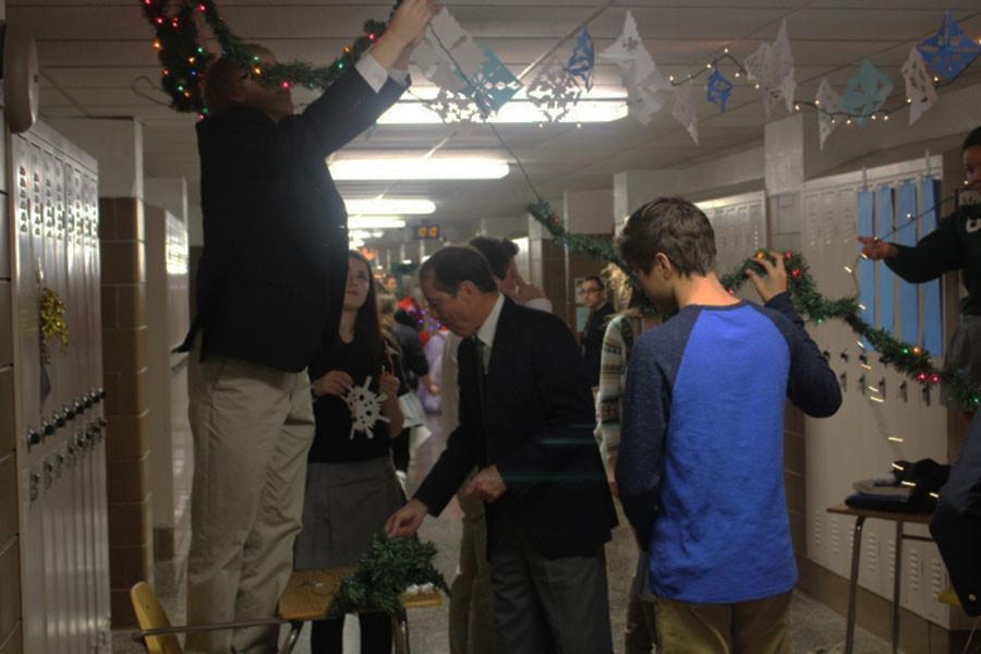 Vice Principal Gary Scholl and members of his advisory decorate their door for the Fellowship of Christian Athletes door decorating contest. Advisories compete in the competition in areas such as overall decoration and creativity.