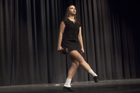 Senior Casey Smial performs an Irish dance routine wearing hard shoes. She has been Irish dancing ever since she was six years old.