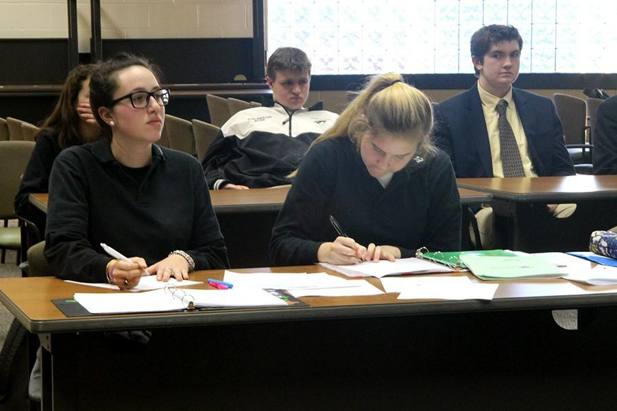 Senior Olivia Stepanian and junior Grace Mottley listen to the opposing team's closing argument at a Mock Trial scrimmage on Monday, Jan. 11. The Mock Trial team was scrimmaging in preparation for their first trial against Fallston High School on Jan.12.