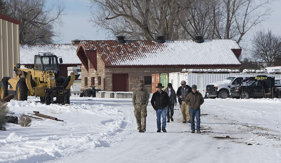 Occupiers of the Malheur National Wildlife Refuge headquarters walk around the grounds of the facility on Jan. 6, 2016 near Burns, Ore.