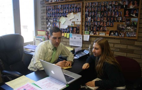 Guidance counselor Larry Hensley helps junior Sydney Shupe plan classes for her senior year. Shupe chose a variety of AP and honors classes to help her prepare for college.