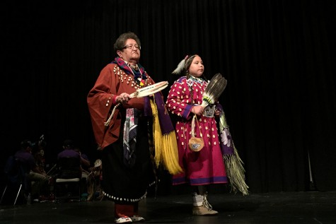 Nellie Speelman, who is St. Labre's Home-School Coordinator, and a student prepare to perform the Women's Traditional Dance during a presentation at The Morning Star Powwow.