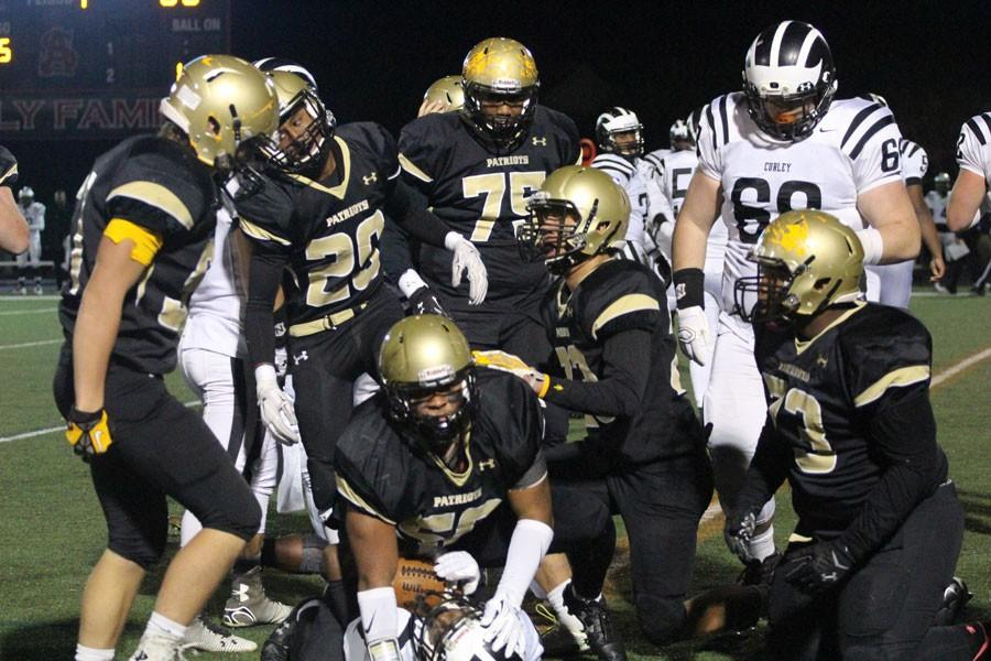 Senior inside linebacker Damon Lloyd comes up after tackling Archbishop Curley ball carrier. Lloyd was presented with the Gerry Gray award on Jan. 17.