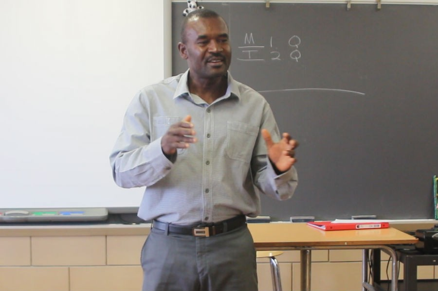 Founder of Haitian school St. Rose de Lima Gaby Thelus speaks to a class of juniors. Thelus gave an inspiring speech about hope and creating an impact in his community.