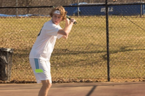 Senior Drew Isennock warms up before the start of practice. Isennock started tennis last year, propelling himself and Kevin Smith as the #1 doubles team.