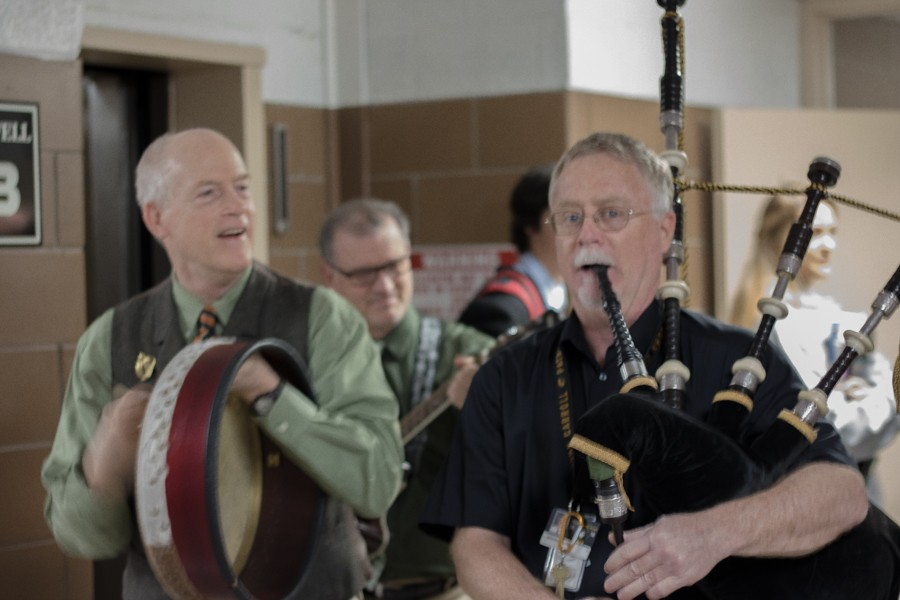 Fine Arts teacher Michael Gaudreau (left) and math teacher Andrew McIntyre (right) play the drum and bagpipe on the morning of March 17. McIntyre and Gaudreau walked around the school playing Irish songs for St. Patrick's Day that morning.
