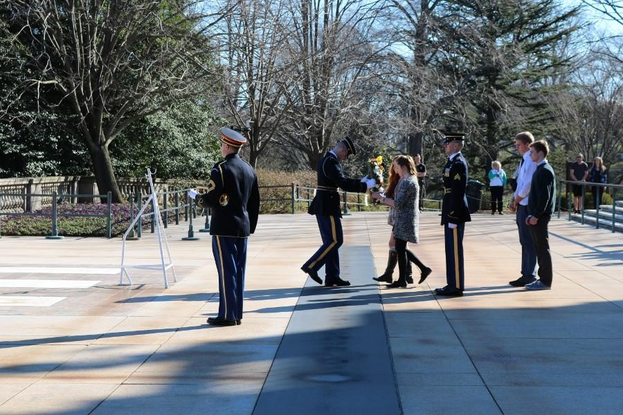 Seniors Kristen Flanagan, Lauren Karbler, Joe Kyburz, and Jake Dengler participate in a laying of the wreath ceremony at the Tomb of the Unknown Soldier to honor the fallen. This was one of the locations visited on the seniors' trip Washington D.C. on Feb. 29.