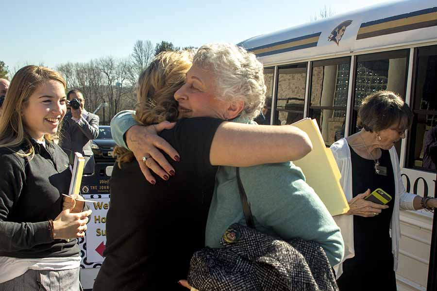 Holocaust survivor Vera Kestenberg arrives and embraces her guide, senior Madison Hooper. On March 1, 18 speakers came to share stories from the Holocaust and the aftermath of the genocide of six million Jews and five million others.