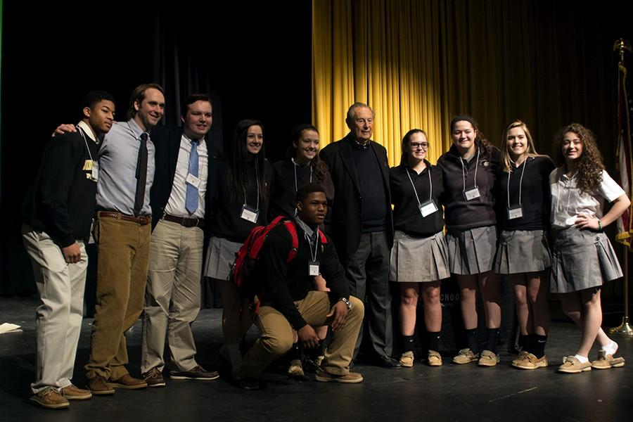 Sol Goldstein posed with U.S. History teacher Darrion Siler and his students after sharing his story. Goldstein was available for pictures and comments after he finished speaking.