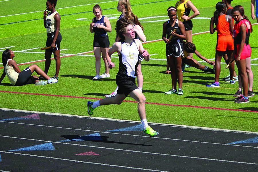 Senior Matt Becker sprints to the line in the 800 meter race. Becker's interest in track and field started when he was a freshman in high school, and has continued running throughout his four years.