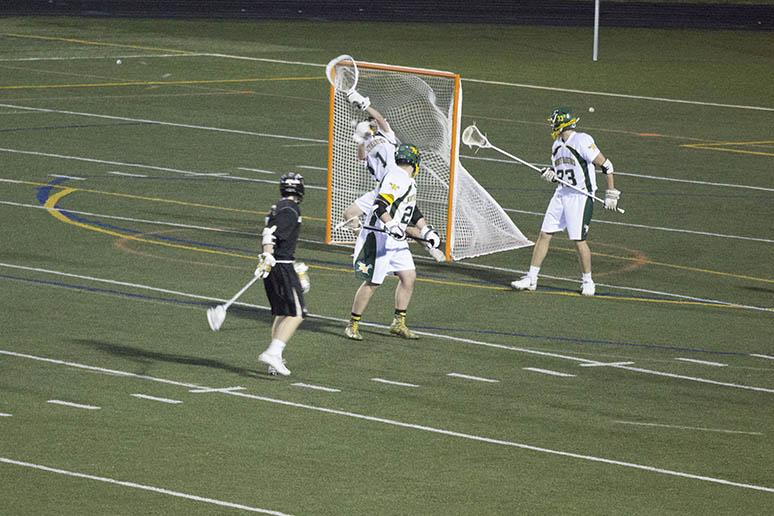Sophomore varsity mens lacrosse attackman Keiron Leonard stares down his shot just after scoring against North Harford. The mens lacrosse team defeated the North Harford 11-10, with a goal in the final seconds of the game.