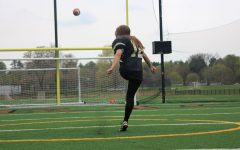 Junior Sarah Meyerl kicks a field goal while wearing the JC football pads. Meyerl aspires to play football her senior year and inspire young girls to play the sports they want regardless of gender.