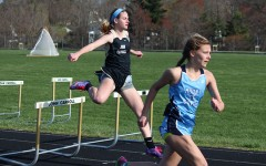Junior Taylor Brewer leaps over the last hurdle before sprinting towards the finish line of the 200 meter hurdles. John Carroll beat Seton Keough and McDonough but lost to Mount de Sales on  Wednesday April 6.