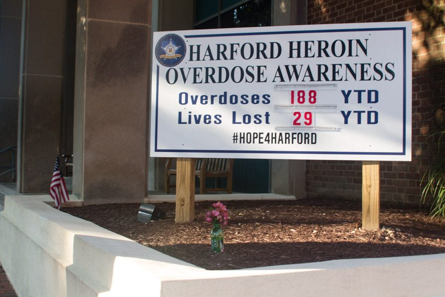 Outside the Bel Air Harford County Sheriff's Department precinct is a sign that displays the current number of overdoses and deaths by heroin in Harford County. The new drug testing policy was implemented in response to the drug epidemic in the county.
