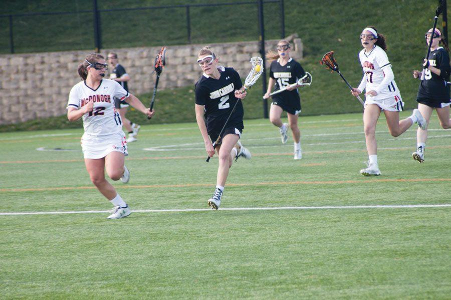 Junior Abby Hormes charges forward with the ball on a fast break. The Patriots fell to McDonough, 16-10, on April 8.