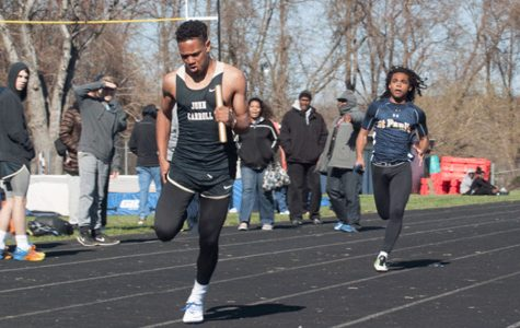 Freshman Ayo Bodison sprints to the finish line during a relay while in a meet against multiple high schools in Maryland. The men's track team capped their successful season off with a MIAA championship.